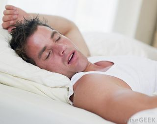 Man-in-white-sleeping-in-bed